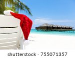 santa hat on chair with water... | Shutterstock . vector #755071357
