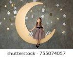 little girl in gray dress is... | Shutterstock . vector #755074057