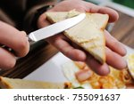 hand with a knife spreads... | Shutterstock . vector #755091637