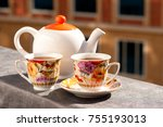 a kettle and tea on the balcony.... | Shutterstock . vector #755193013