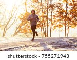 man jogging outdoors on cold... | Shutterstock . vector #755271943