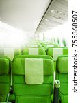 green airplane seats in cabin.... | Shutterstock . vector #755368507