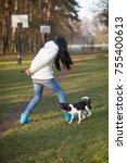 young woman trains the dog in... | Shutterstock . vector #755400613