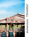 Small photo of MAY 20, 2014 Koh Lanta, Thailand : Koh Lanta old town wooden ocean house in fisherman village, traditional local fisherman's house.