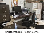 Busy, messy, cluttered, funky office space. - stock photo