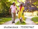 senior couple walking with pet... | Shutterstock . vector #755507467