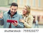 woman surprising her boyfriend... | Shutterstock . vector #755523277