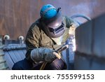male  worker wearing protective ... | Shutterstock . vector #755599153