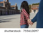 happy young couple walking by... | Shutterstock . vector #755613097
