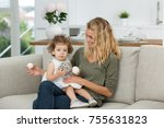 beautiful baby with her mother | Shutterstock . vector #755631823