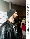 Small photo of Hamburg, Germany - November 10, 2017: The WWE Superstar Seth Rollins on the Red Carpet Event during WWE Live Tour 2017