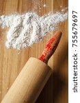 roller pin and flour on wood. | Shutterstock . vector #755679697