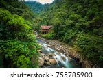 a jungle lodge by a river in...   Shutterstock . vector #755785903
