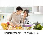 happy asian couple cooking in... | Shutterstock . vector #755902813