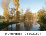 Small photo of Waterreflections of autumny trees in the morning