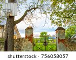 a gates in a cemetery with a... | Shutterstock . vector #756058057