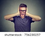 Small photo of stressed man frustrated can't tolerate anymore loud noise. Negative human emotions