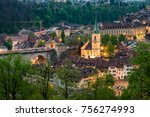Small photo of Scenic View of Bern and Nydeggkirche Bronze Church in Switzerland, View of the Old City of Bern from The Stone Bridge, over Aare river, Switzerland.
