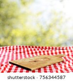 Small photo of Empty table with empty cutting board for product display montages
