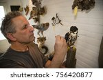 taxidermist preparing and... | Shutterstock . vector #756420877
