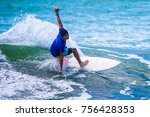 riding the waves. costa rica ... | Shutterstock . vector #756428353