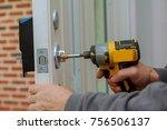 install the door handle with a... | Shutterstock . vector #756506137