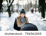 a happy young mother walks with ... | Shutterstock . vector #756561043