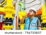 engineer with his walkie talkie ... | Shutterstock . vector #756733837