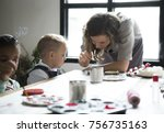 teacher showing how to decorate | Shutterstock . vector #756735163