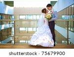happy bride and groom is... | Shutterstock . vector #75679900
