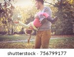 father spending time in nature... | Shutterstock . vector #756799177