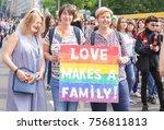 Small photo of KYIV, UKRAINE - JUNE 18, 2017: Women with rainbow agitative poster on gay pride outdoors
