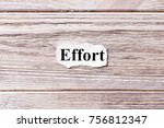Small photo of Effort of the word on paper. concept. Words of Effort on a wooden background.
