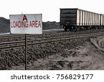 a pile of coal next to a train... | Shutterstock . vector #756829177