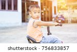 a cute kid riding a bicycle | Shutterstock . vector #756833857