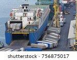 trucks transport docked ferry... | Shutterstock . vector #756875017