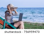 woman sitting with a laptop on... | Shutterstock . vector #756959473