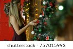 young girl decorate christmas... | Shutterstock . vector #757015993