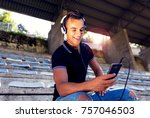 young smiling man listening to... | Shutterstock . vector #757046503