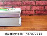 colored pencils on wooden desk... | Shutterstock . vector #757077313