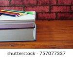 colored pencils on wooden desk... | Shutterstock . vector #757077337