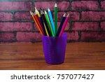 colored pencils on wooden desk... | Shutterstock . vector #757077427