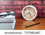 books  desk clock  glasses and... | Shutterstock . vector #757081687