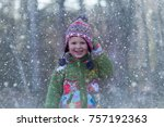 a young boy is outside in a... | Shutterstock . vector #757192363