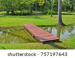 Red Wooden Bridge Over Small...