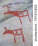 Small photo of prehistoric rock carving petroglyphs on stone surface closeup, Alta, Norway