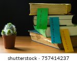 stack of books with paper