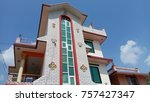 tall house touching the sky. | Shutterstock . vector #757427347