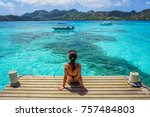 woman sitting on the deck in... | Shutterstock . vector #757484803