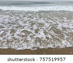 waves on rushing towards the... | Shutterstock . vector #757519957